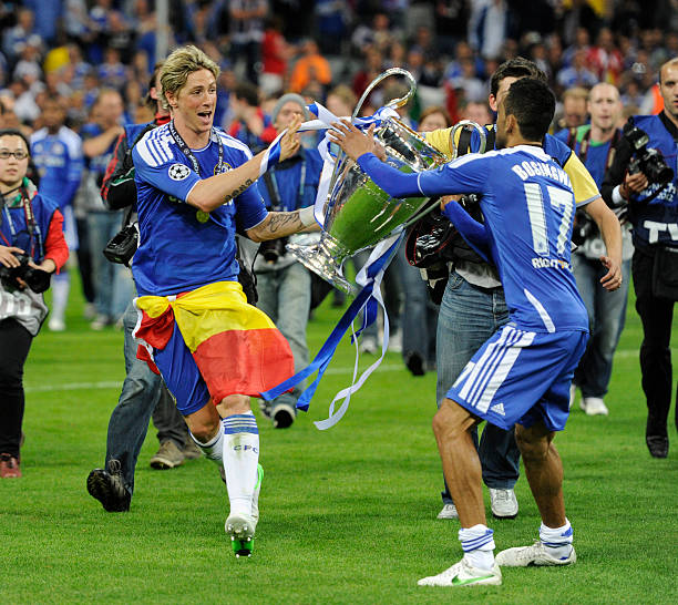 Fernando Torres Of Chelsea Passes The Trophy To Team Mate Jose Bosingwa 17