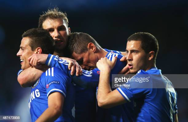 Fernando Torres of Chelsea reacts with team mates after scoring the opening goal during the UEFA Champions League semifinal second leg match between...