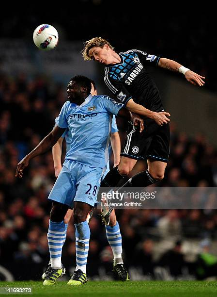 Fernando Torres of Chelsea rises above Kolo Toure of Manchester City to win a header during the Barclays Premier League match between Manchester City...