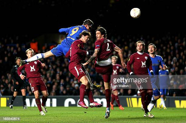Fernando Torres of Chelsea rises above the Rubin Kazan defence to score his team's third goal with a header during the UEFA Europa League quarter...