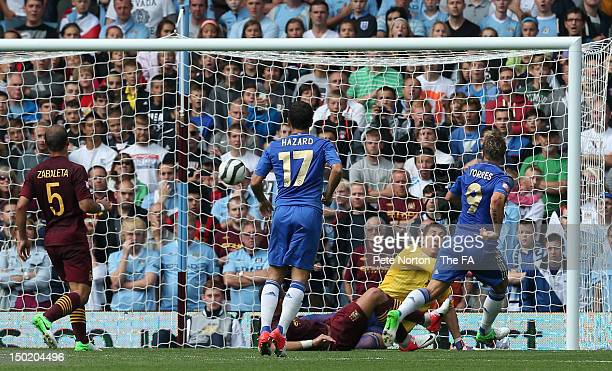 Fernando Torres of Chelsea scores the opening goal during the FA Community Shield match between Manchester City and Chelsea at Villa Park on August...