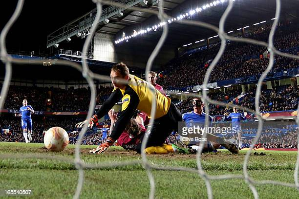Fernando Torres of Chelsea scores the opening goal past goalkeeper Sergei Ryzhikov of Rubin Kazan during the UEFA Europa League quarter final first...