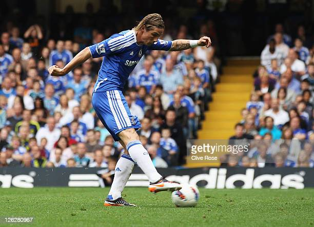 Fernando Torres of Chelsea scores their first goal during the Barclays Premier League match between Chelsea and Swansea City at Stamford Bridge on...