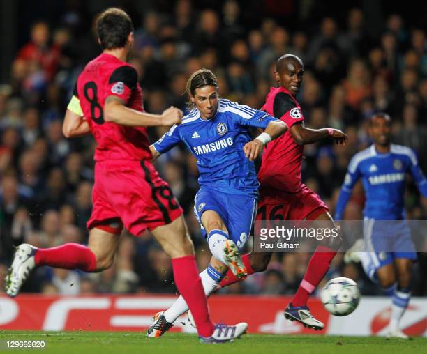 Fernando Torres of Chelsea scores their second goal during the UEFA Champions League group E match between Chelsea and Genk at Stamford Bridge on...