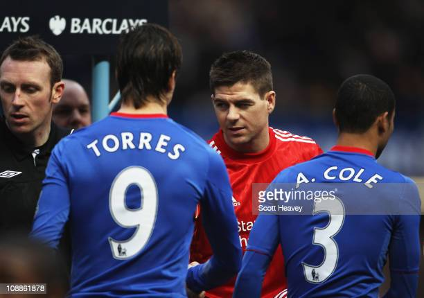 Fernando Torres of Chelsea shakes hands with former team mate Steven Gerrard of Liverpool prior to the Barclays Premier League match between Chelsea...
