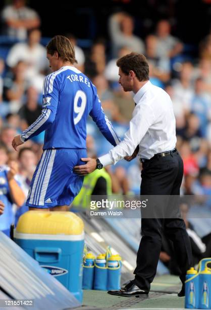 Fernando Torres of Chelsea shakes hands with his manager Andre VillasBoas during the Barclays Premier League match between Chelsea and West Bromwich...