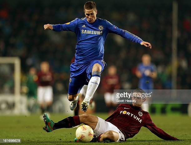 Fernando Torres of Chelsea skips past the challenge of Mario Holek of Sparta Praha during the UEFA Europa League match between AC Sparta Praha and...