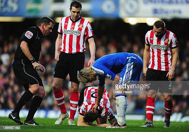 Fernando Torres of Chelsea stands over an injured Matthew Kilgallon of Sunderland during the Barclays Premier League match between Chelsea and...