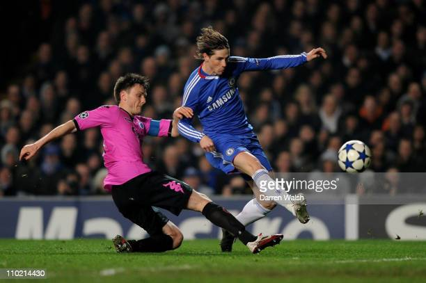 Fernando Torres of Chelsea takes a shot on goal under pressure from William Kvist of Copenhagen during the UEFA Champions League Round of 16 2nd leg...