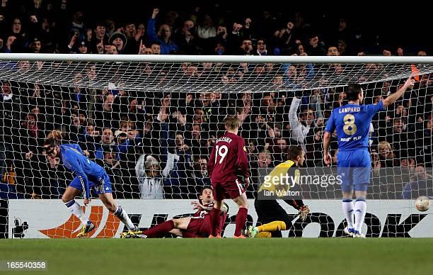 Fernando Torres of Chelsea turns away to celebrate after scoring the opening goal past goalkeeper Sergei Ryzhikov of Rubin Kazan during the UEFA...