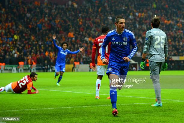 Fernando Torres of Chelsea turns to celebrate scoring the opening goal during the UEFA Champions League Round of 16 first leg match between...