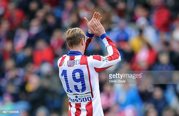 Fernando Torres of Club Atletico de Madrid applauds fans after he is substituted late in the 2nd half of the La Liga match between Club Atletico de...