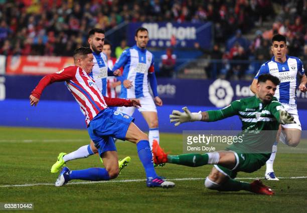 Fernando Torres of Club Atletico de Madrid beats Iago Herrerin of CD Leganes to score his team's opening goal during the La Liga match between Club...