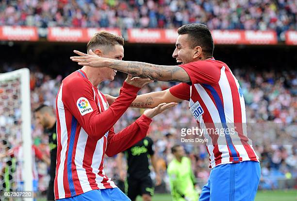 Fernando Torres of Club Atletico de Madrid celebrates with Angel Correa after scoring his team's 4th goal during the La Liga match between Club...