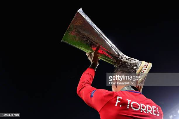 Fernando Torres of Club Atletico de Madrid celebrates with the trophy after winning the UEFA Europa League Final between Olympique de Marseille and...