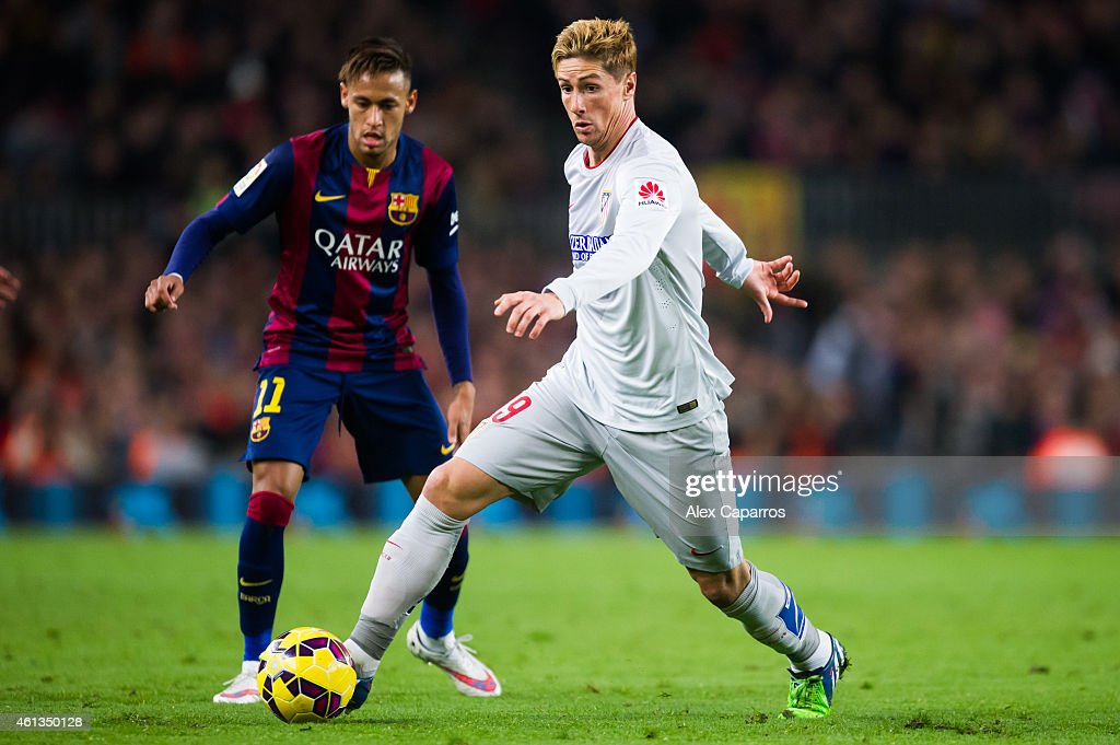 Fernando Torres of Club Atletico de Madrid controls the ball next to Neymar Santos Jr of FC Barcelona during the La Liga match between FC Barcelona and Club Atletico de Madrid at Camp Nou on January 11, 2015 in Barcelona, Spain.
