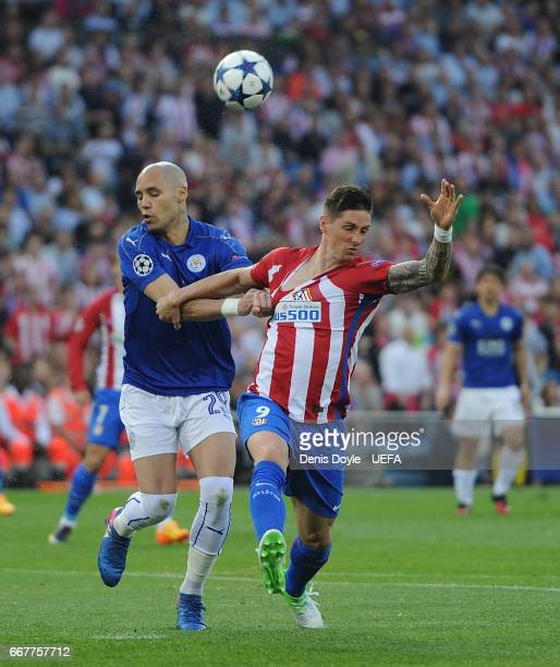 Fernando Torres of Club Atletico de Madrid is tackled by Yohan Benalouane of Leicester City during the UEFA Champions League Quarter Final first leg...
