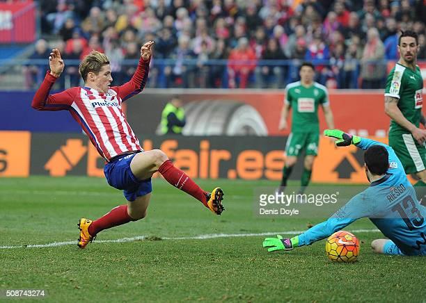 Fernando Torres of Club Atletico de Madrid scores his team's 3rd goal against Asier Riesgo of SD Eibar during the La Liga match between Club Atletico...
