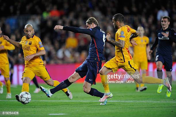 Fernando Torres of Club Atletico de Madrid scores his team's opening goal during the UEFA Champions League Quarter Final First Leg match between FC...
