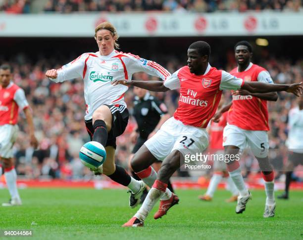 Fernando Torres of Liverpool and Emmanuel Eboue of Arsenal battle for the ball during the Barclays Premier League match between Arsenal and Liverpool...