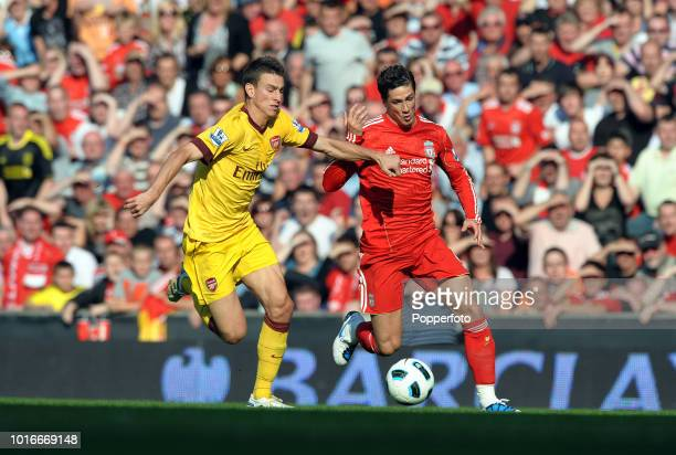 Fernando Torres of Liverpool and Laurent Koscielny of Arsenal in action during the Barclays Premier League match between Liverpool and Arsenal at...