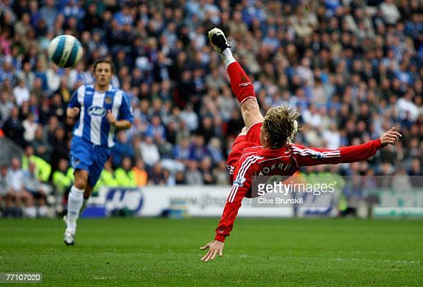 Fernando Torres of Liverpool attempts an aerial volley at goal against Wigan during the Barclays Premier League match between Wigan and Liverpool at...