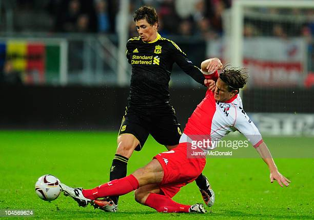 Fernando Torres of Liverpool battles with Edouard Duplan of FC Utrecht during the UEFA Europa League match between FC Utrecht and Liverpool at the...