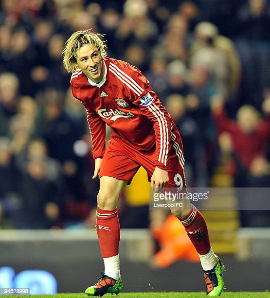 Fernando Torres of Liverpool celebrates after scoring a goal against Wigan Athletic during the Barclays Premier League match between Liverpool and...