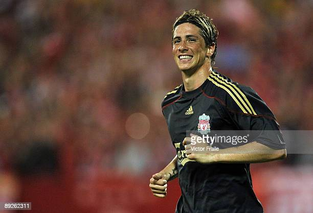 SINGAPORE JULY 26 Fernando Torres of Liverpool celebrates after scoring against Singapore during their preseason friendly soccer match at the...