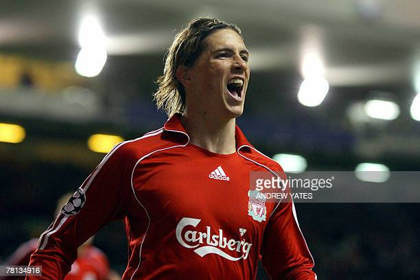 Fernando Torres of Liverpool celebrates after scoring his second goal during the Uefa Champions League football match against Porto at Anfield in...