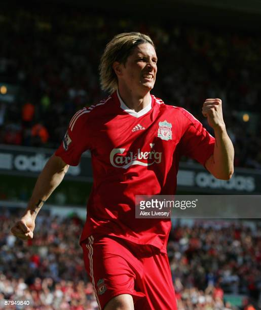 Fernando Torres of Liverpool celebrates after scoring the opening goal during the Barclays Premier League match between Liverpool and Tottenham...