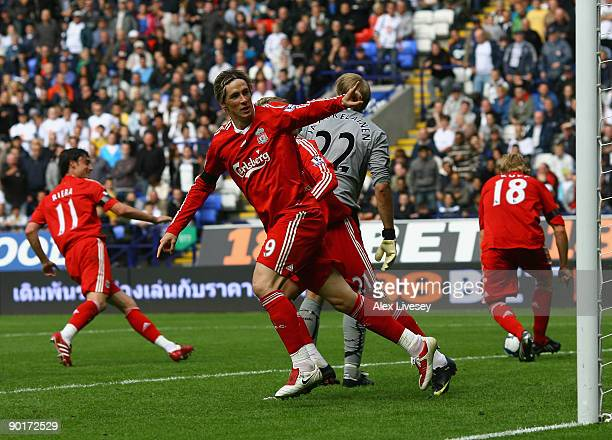 Fernando Torres of Liverpool celebrates after scoring the second goal for Liverpool during the Barclays Premier League match between Bolton Wanderers...