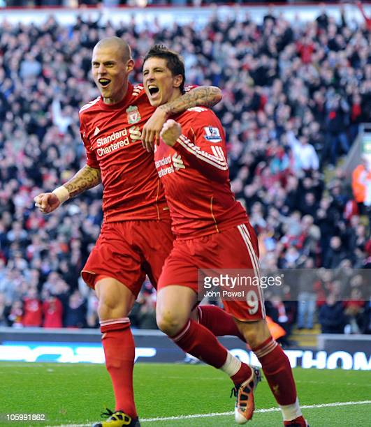 Fernando Torres of Liverpool celebrates his goal with Martin Skrtel of Liverpool during the Barclays premier league match between Liverpool and...