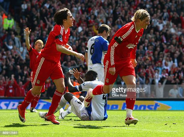 Fernando Torres of Liverpool celebrates his second goal during the Barclays Premier League match between Liverpool and Blackburn at Anfield on April...