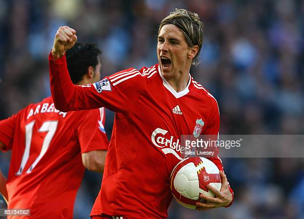 Fernando Torres of Liverpool celebrates scoring his team's first goal during the Barclays Premier League match between Manchester City and Liverpool...