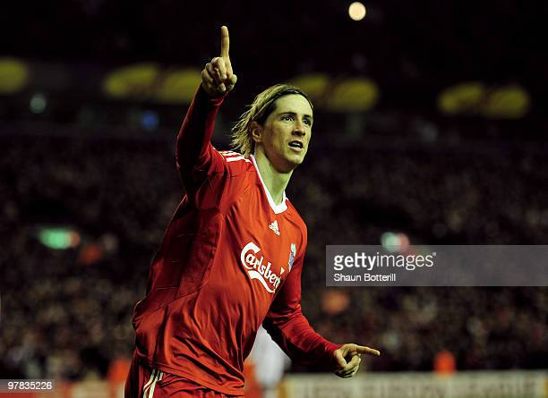 Fernando Torres of Liverpool celebrates scoring his team's second goal during the UEFA Europa League Round of 16 second leg match at Anfield on March...