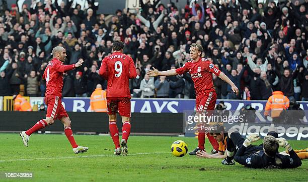 Fernando Torres of Liverpool celebrates scoring his team's third goal with team mates during the Barclays Premier League match between Wolverhampton...