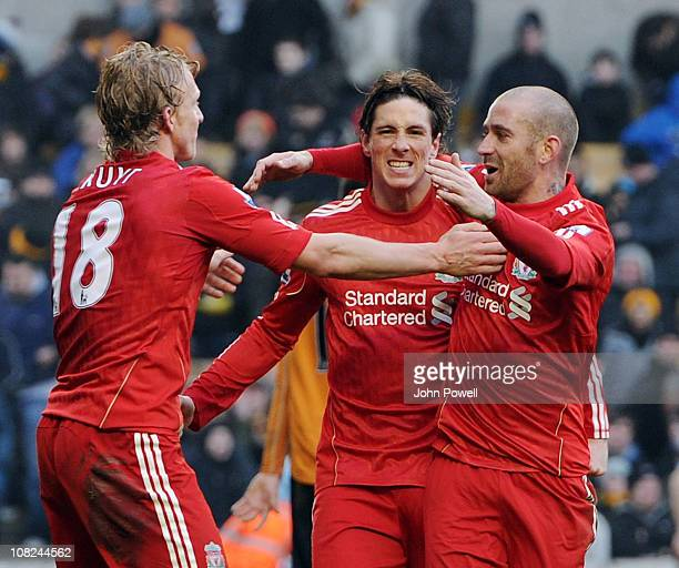 Fernando Torres of Liverpool celebrates scoring his team's third goal during the Barclays Premier League match between Wolverhampton Wanderers and...