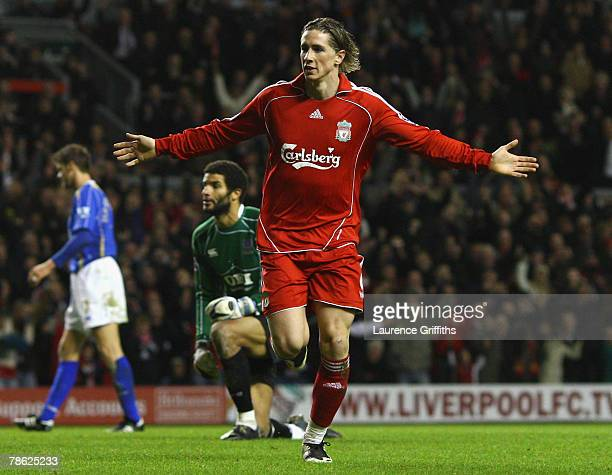 Fernando Torres of Liverpool celebrates scoring his team's third goal during the Barclays Premier League match between Liverpool and Portsmouth at...