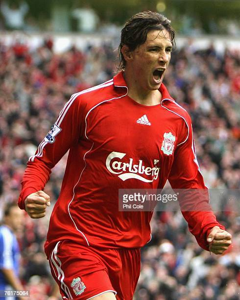 Fernando Torres of Liverpool celebrates scoring the opening goal during the Barclays Premier League match between Liverpool and Chelsea at Anfield on...
