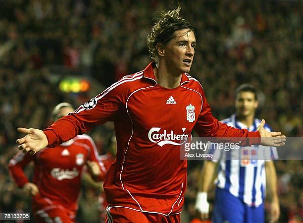 Fernando Torres of Liverpool celebrates scoring the opening goal during the UEFA Champions League Group A match between Liverpool and FC Porto at...
