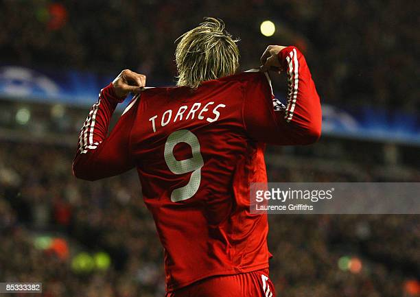 Fernando Torres of Liverpool celebrates scoring the opening goal during the UEFA Champions League Round of Sixteen, Second Leg match between...