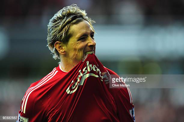 Fernando Torres of Liverpool celebrates scoring the opening goal during the Barclays Premier League match between Liverpool and Manchester United at...