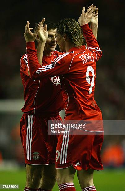 Fernando Torres of Liverpool celebrates scoring the opening goal with team mate Steven Gerrard during the UEFA Champions League Group A match between...