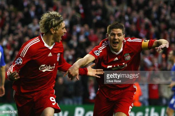 Fernando Torres of Liverpool celebrates scoring the opening goal with team mate Steven Gerrard during the UEFA Champions League Quarter Final First...