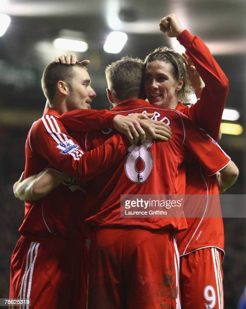 Fernando Torres of Liverpool celebrates with his team mates after scoring his team's fourth goal during the Barclays Premier League match between...