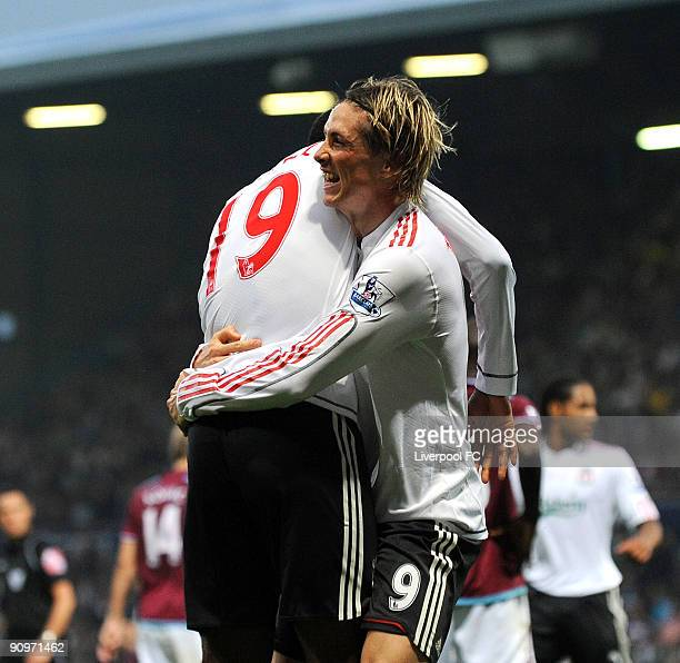 Fernando Torres of Liverpool celebrates with Ryan Babel after scoring the 32 goal for their team during the Barclays Premier League match between...