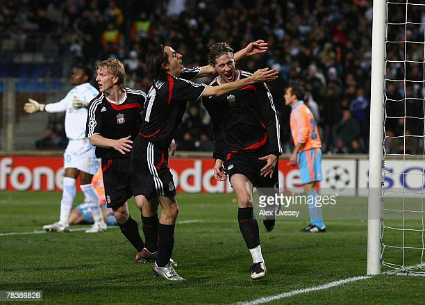 Fernando Torres of Liverpool celebrates with Yossi Benayoun after scoring the second goal during the UEFA Champions League Group A match between...