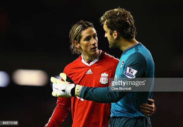 Fernando Torres of Liverpool chats with Manuel Almunia of Arsenal at the end of the Barclays Premier League match between Liverpool and Arsenal at...