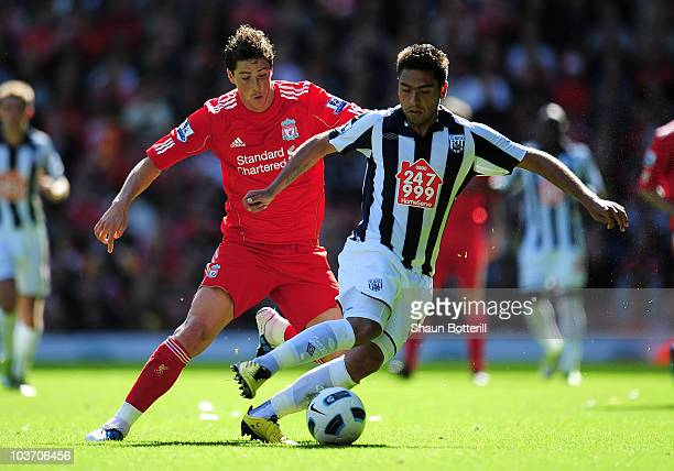 Fernando Torres of Liverpool competes for the ball with Gonzalo Jara of West Bromwich Albion during the Barclays Premier League match between...